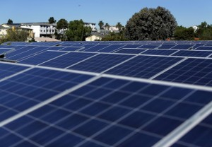 Solar panels are shown on top of a Multifamily Affordable Solar Housing-funded (MASH) housing complex in National City, California November 19, 2015. Picture taken November 19. To match Insight USA-SOLAR/MINORITIES REUTERS/Mike Blake